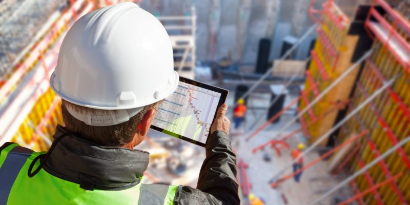 Civil,Engineer,Or,Architect,With,Hardhat,On,Construction,Site,Checking