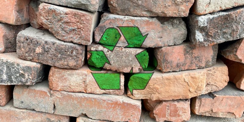 Recycling,Arrow,Icon,On,Red,Bricks,Pile,From,Construction,Site,